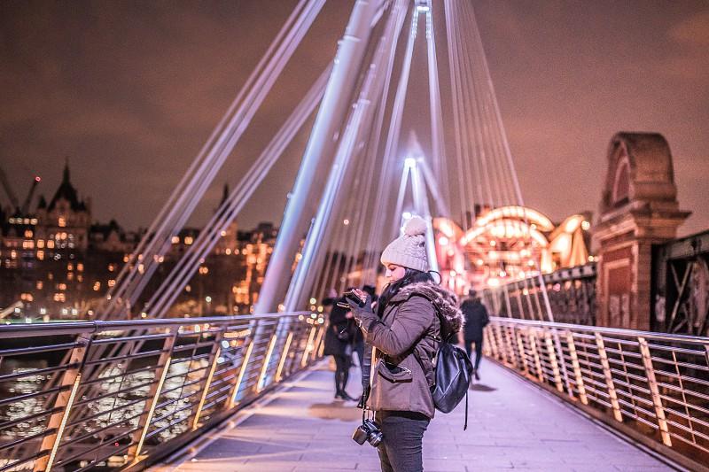 tourist in a bridge London. photo