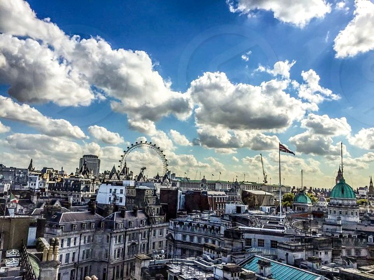Outdoor day horizontal London England. U.K. roof rooftop flag Union Jack cloud cloudy London eye buildings architecture  photo