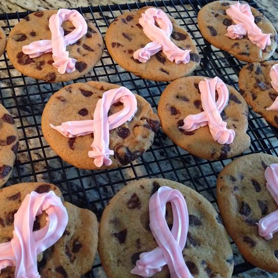 Chocolate chip cookies; pink ribbon; cooling rack; granite countertop; dessert photo