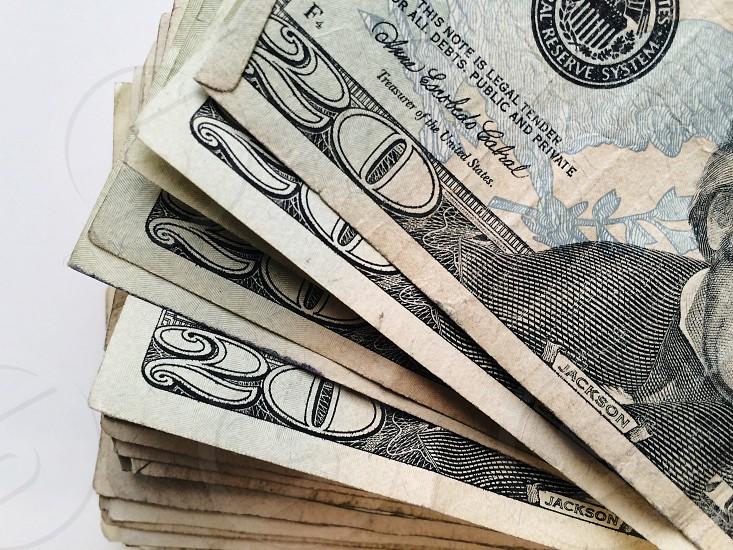 stack of united states 20 dollar bills photo