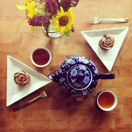 2 white triangle shaped plate and blue teapot  photo