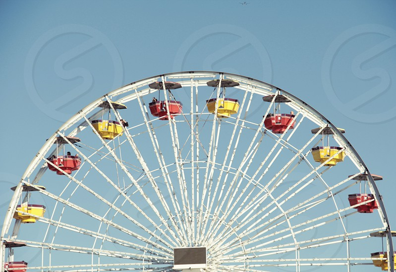 white ferris wheel with yellow and red carts photo