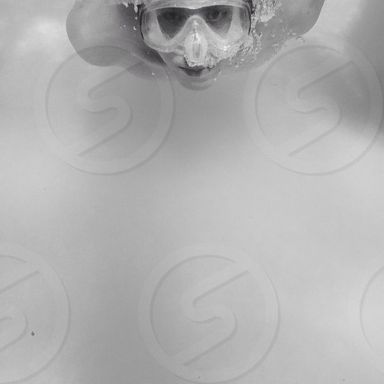 person swimming and wearing goggles photo