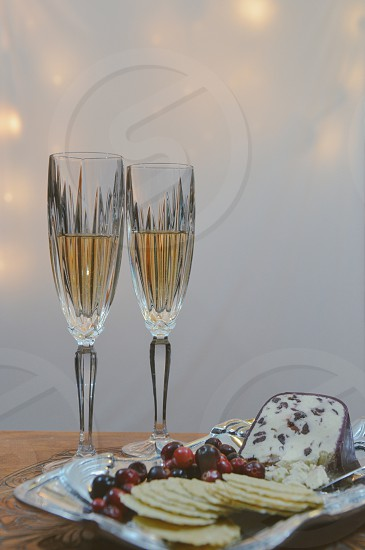Happy New Years celebrate celebration champagne glasses cheese crackers cranberries lights photo