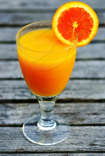 A glass of fresh orange juice photo