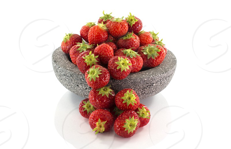 plate with red strawberries isolated on white photo