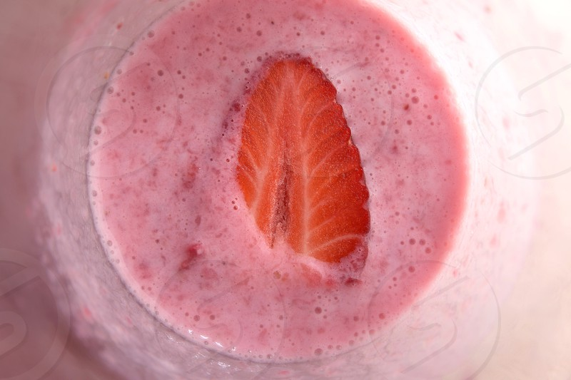 Halved Strawberry in Milk Shake Closeup Top View photo