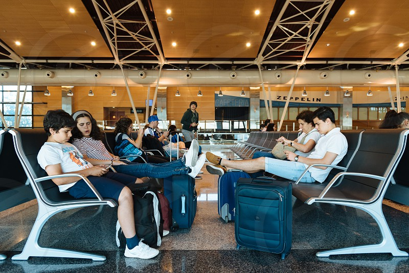 Unidentified people waiting in boarding gate lounge in  Barajas - Adolfo Suarez Airport photo