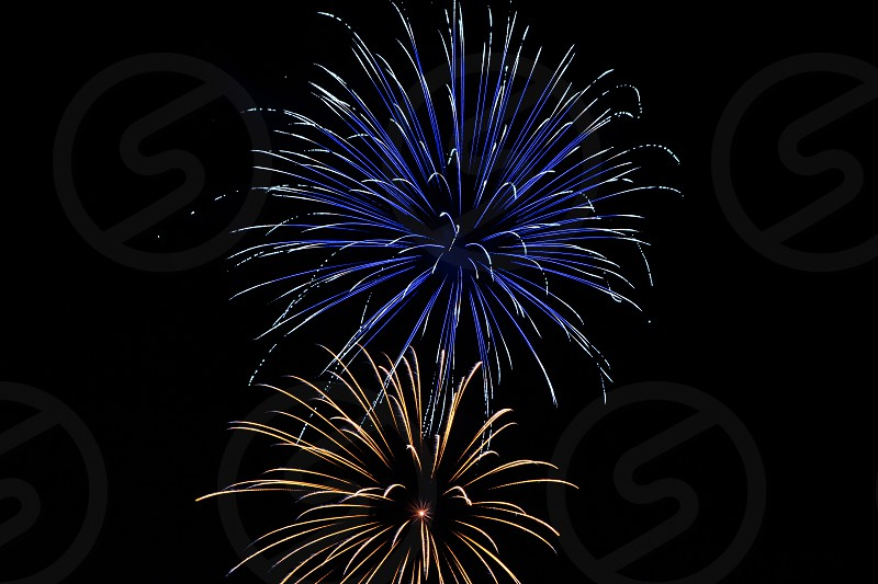 blue and yellow fireworks display photo