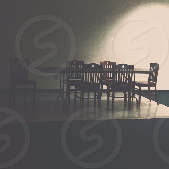 rectangular brown wooden dining table with six padded chairs photo
