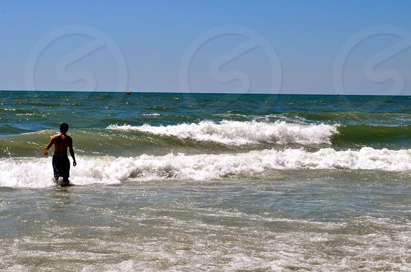 Boy in waves - Myrtle Beach South Carolina - USA photo