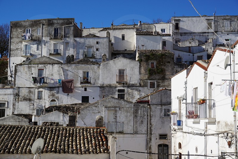 White houses and blue sky in the Junno neighbourhood Monte Sant'Angelo Gargano Italy photo