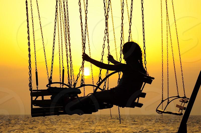 woman riding on swing photo