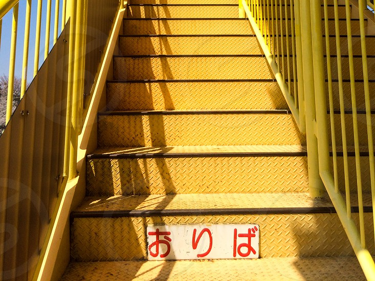 JAPAN japanese down step yellow iron stairs danger rust photo