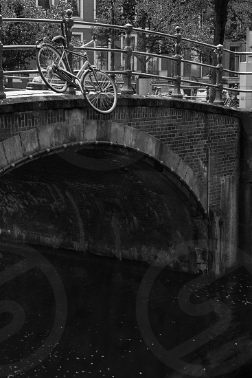 Amsterdam is filled with bicycles and canals. photo