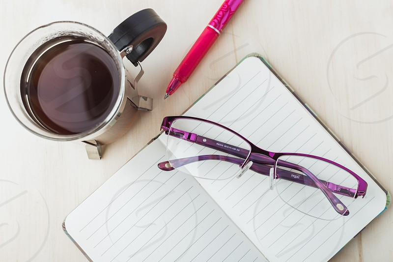 Woman glasses with notebook coffee and pencil photo