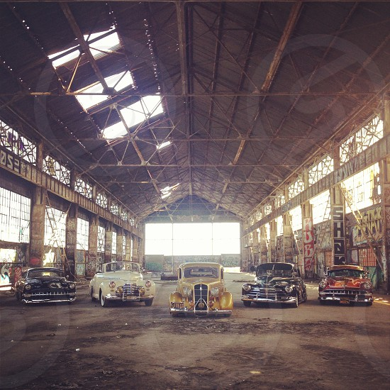 5 vintage cars inside the warehouse  photo