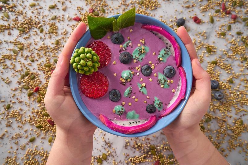 Acai bowl smoothie with chia strawberry blueberry seeds and pitaya dragon fruit photo