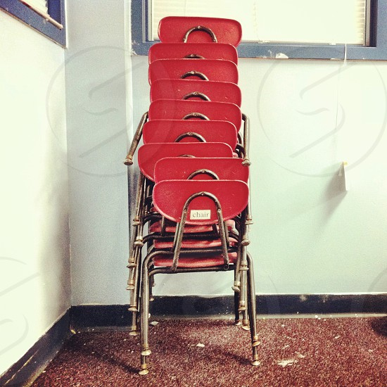 A stack of red school chairs photo