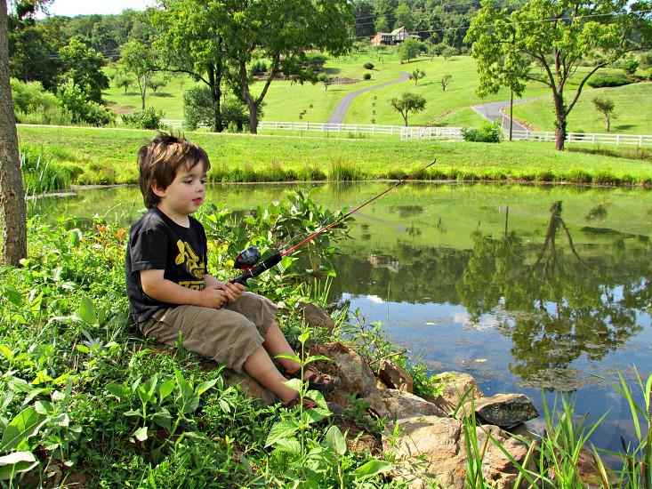 Little boy blissfully fishing. photo