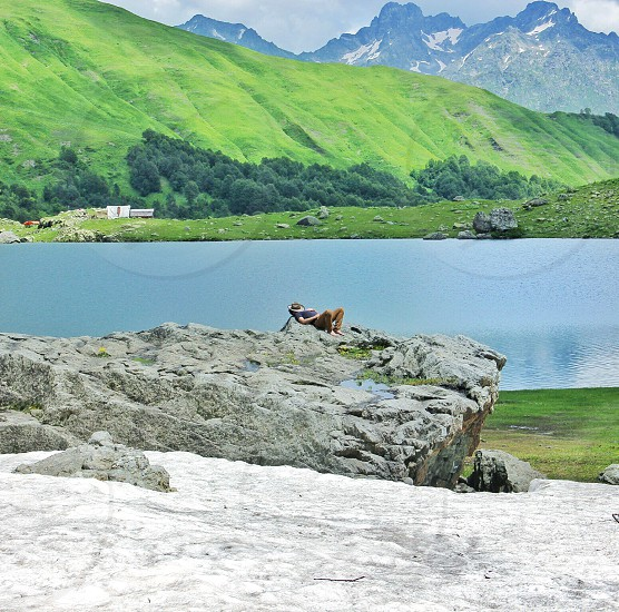 concrete stone on white sand during daytime photo