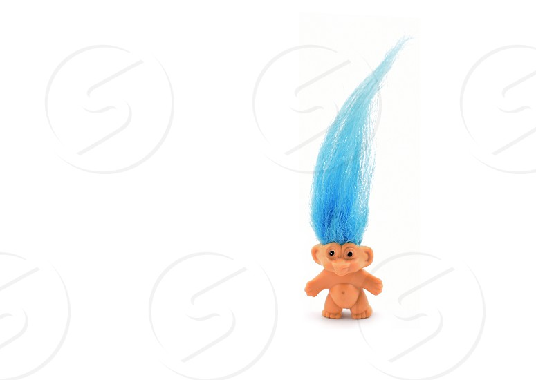 Troll with blue hair. Elf isolated on a white background photo