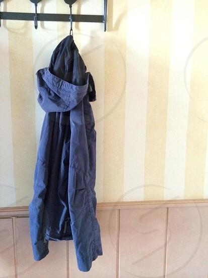 blue jacket on coat rack photo