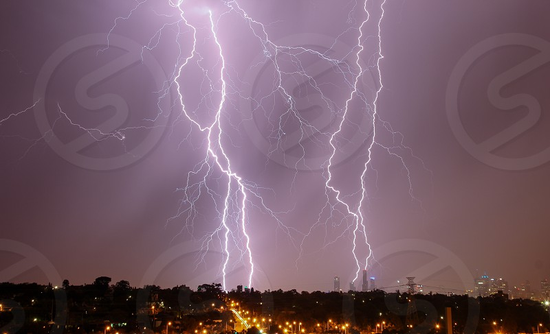 Lightning strikes over Melbourne city skyline photo