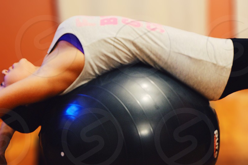 woman lying on a rubber ball photo