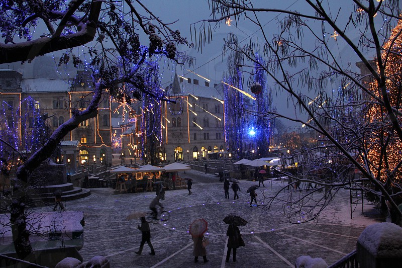 Holiday lights and alight snow in the central Preseren Square in Ljubljana Slovenia. photo
