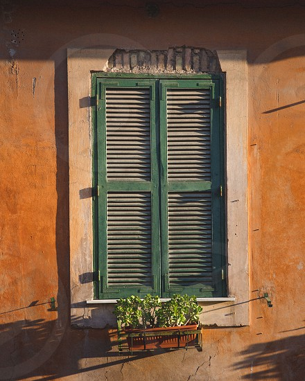 The rustic windows of Italy at sunset. photo