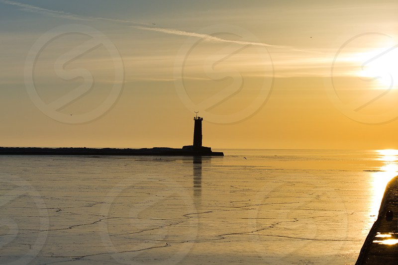 Frozen harbor at sunrise along Lake Michigan in Sheboygan Wisconsin. photo