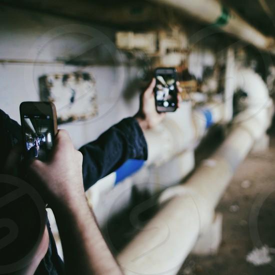people holding smartphone photo