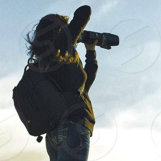 woman in grey denim jeans photo