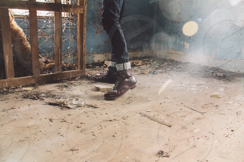 person in brown boots standing photo