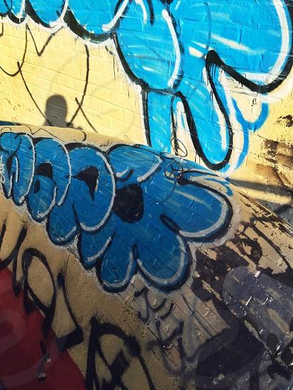 blue red and yellow wall graffiti photo