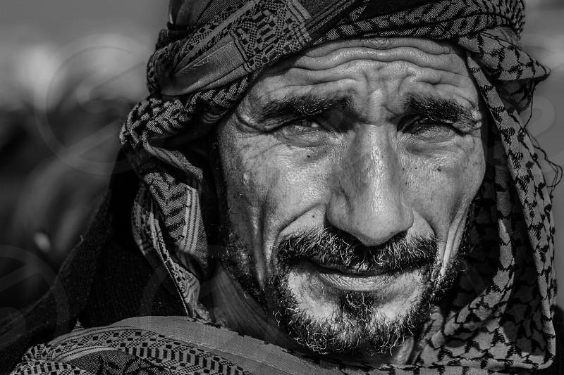 grayscale photography  of man wearing turban photo