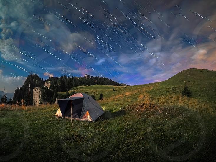 tentcampingstar trailsstarsnightscapesummer nighthikingfull moonmoonlight photo