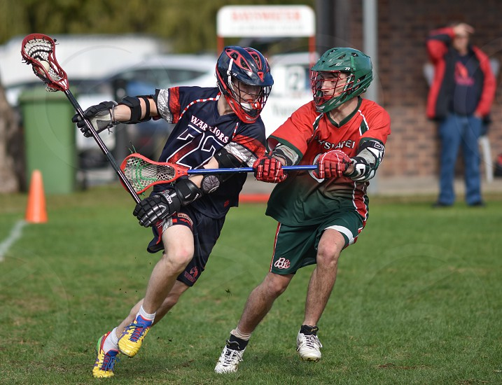 Lacrosse players in action.  photo