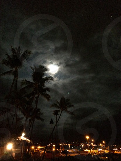 August 10 2014 supermoon over Kailua-Kona Hawai'i. This was a beautiful night with the moon being closer to the earth than normal but with some cloud cover it was great for lighting.  photo