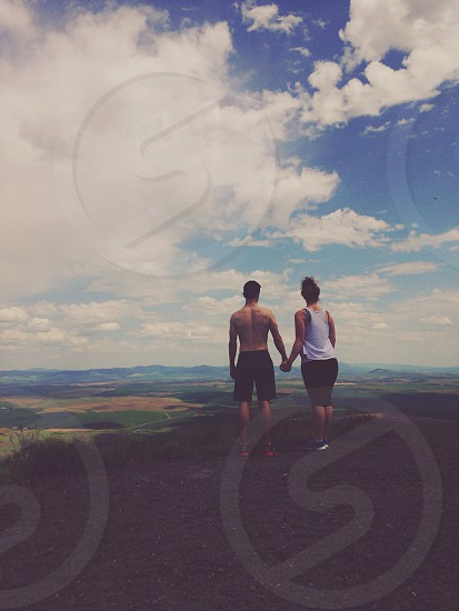 man and woman holding hands image photo