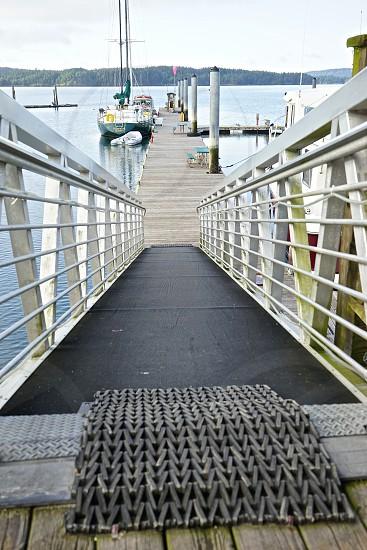 sailboat ramp loading dock water mast railings walking sailing mat boarding Washington State sport relaxation cruising vacation enjoyment photo