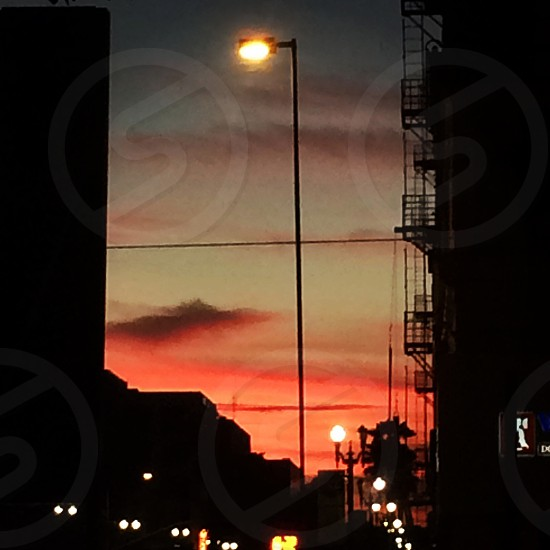 silhouette photo of street light post during golden hour photo
