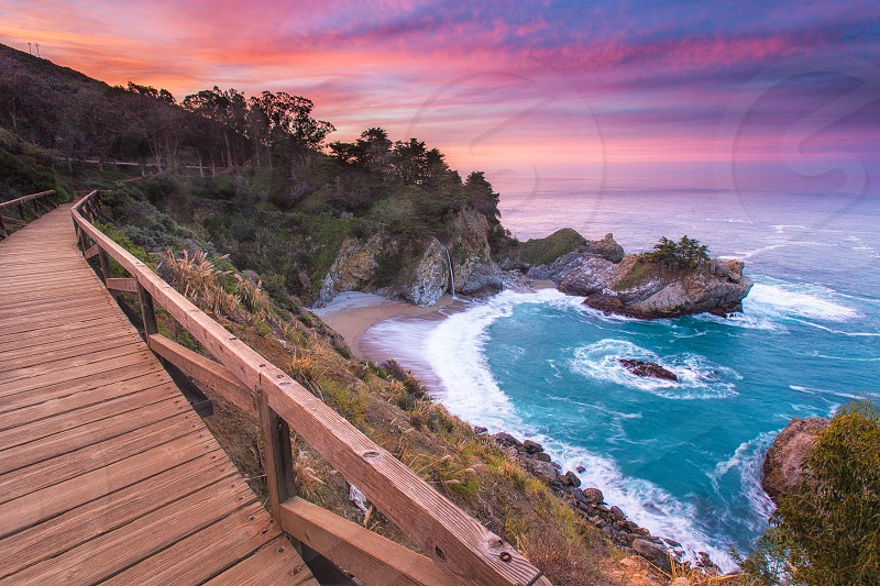 A coastal path winds its way around the remarkable McWay Falls in Big Sur California. photo