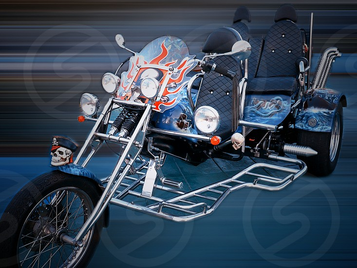 black and chrome 3 wheeled chopper motorcycle photo