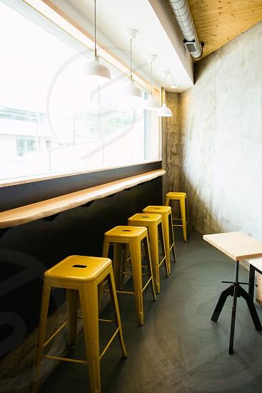 yellow stool under white tracklight photo