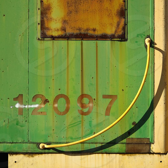 A rusty green Burlington Northern caboose sits on display in Chickasha Oklahoma. photo