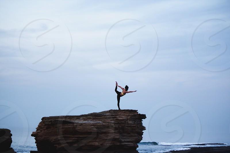 YogagirlskyposeoutdoorswaveseaoceanfreespiritsunsetrockcalmaloneScotland photo