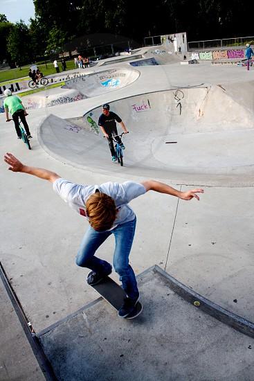 boy skateboarding on ramp during daytime photo