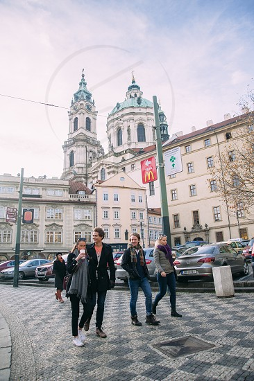 Group of young walking tourists in Prague Czech. photo